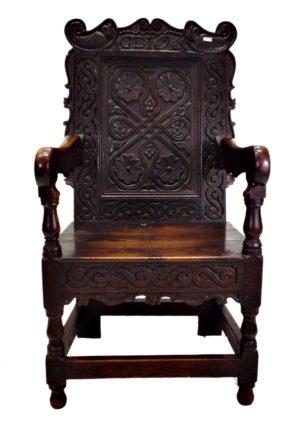 Sillón Frailero de madera de roble macizo tallado. Fechado 1691. Inglés