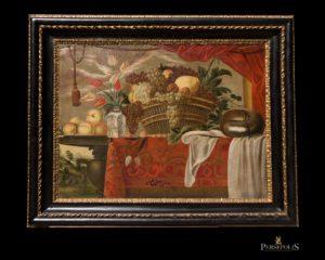 Óleo sobre tela: Bodegón, cesta con frutas y jarrón con flores. Marco talla negro y dorado con oro fino. S. XVII